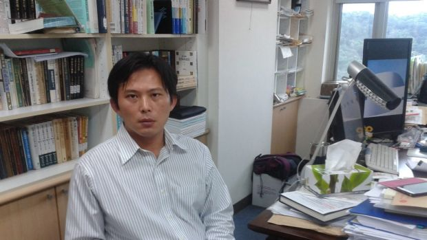 Plugging democracy: Sunflower Movement activist and legal scholar Huang Kuo-chang in his offices at the ...
