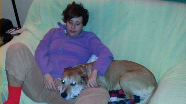 Taken ill: Teresa Romero, the Spanish nurse who contracted Ebola, with her dog, Excalibur.