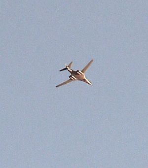 A military plane flies above Kobane on Wednesday.