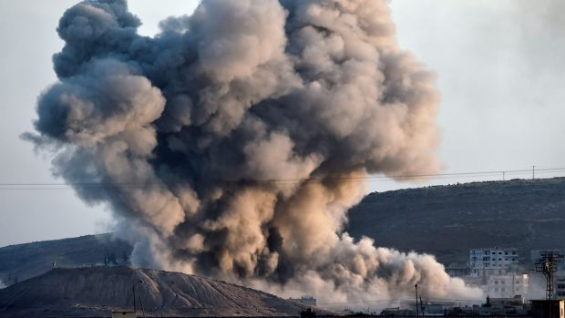 Smoke rises from an air strike on the Syrian town of Kobane, also known as Ayn al-Arab.