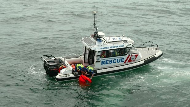 The man's boat was tipped from behind by a wave crossing the bar at Batemans Bay about 10.30am Sunday.