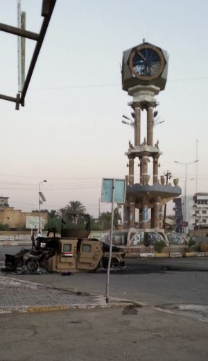 A destroyed Iraqi military vehicle is seen in a main square in the town of Hit in Iraq's western Anbar province.