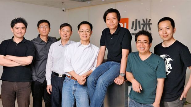 Lei Jun, founder, chairman and CEO of Xiaomi (seated) with his seven co-founders.