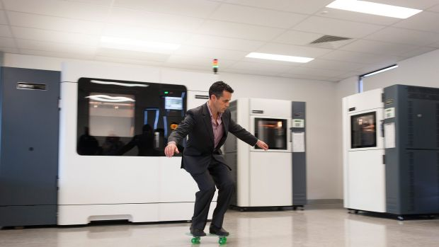 Objective3D CEO Matt Minio on a skate board printed on one of the machines in the background.