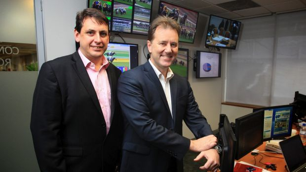 RVL chief steward Terry Bailey and head of integrity Dayle Brown in the  Racing Victoria integrity control room.