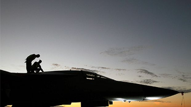 Ground crew prepare  a RAAF F-111 taking part in the aircrafts' last major international excersise Operation Pitch Black ...