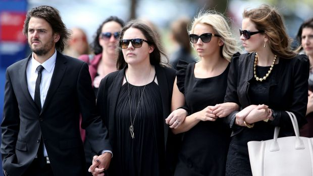 Family members arrive for the service.