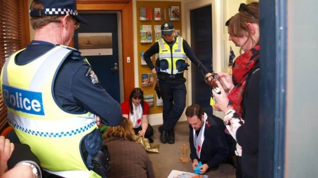 "Police watch the ""prayer sit-in"" inside the Geelong offices of Shadow Immigration Minister Richard Marles."