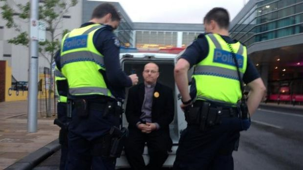Baptist minister Simon Moyle is arrested.