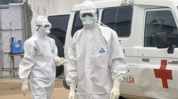 Health workers in Liberia prepare to remove the body of an Ebola victim.