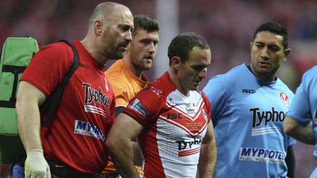 Early exit: Lance Hohaia is helped from the field in the Super League grand final.