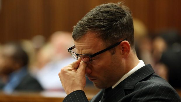 Under strain ... Oscar Pistorius rubs his eyes as he sits in court as the sentencing process entered a second day in ...