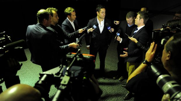 Swamped: Jarryd Hayne is surrounded by the media after making his announcement.