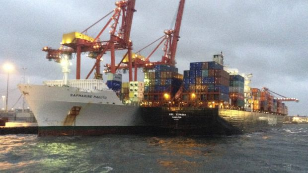 The vessels sit side-by-side after wind blew the Hapag-Lloyd vessel from its moorings.