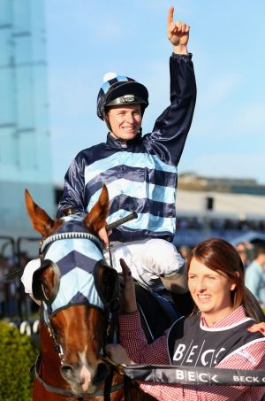One to go: James McDonald celebrates his million-dollar triumph on Shooting to Win in the Caulfield Guineas.  He could ...