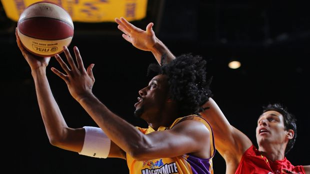Driving to the bucket: Josh Childress scores against Wollongong in his first NBL match.