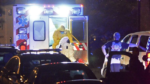 An ambulance carrying Amber Vinson, the second health care worker to be diagnosed with Ebola in Texas, arrives at Emory ...