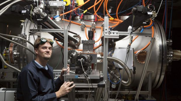 Program leader Tom McGuire stands next to the compact fusion reactor experiment inside his lab at the Skunk Works in ...