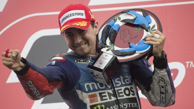 Jorge Lorenzo celebrates victory on the podium in Japan last weekend.