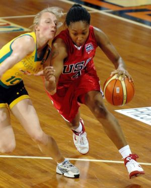 Cappie Pondexter rounds Australian Opals' Samantha Richards back in 2006.