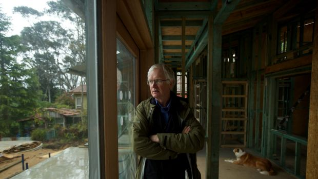 Architect Ross Young, in his half-built home in Katoomba.