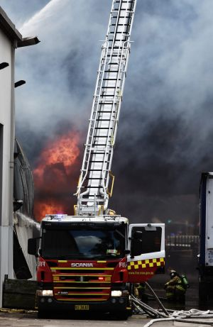 A fire burns out of control in Revesby.