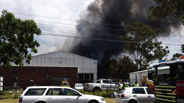 Thick black smoke fills the sky as a blaze burns in south-west Sydney.