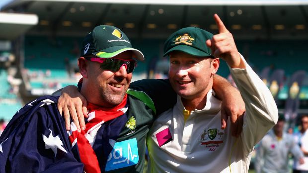 Happy days: Darren Lehmann and Michael Clarke celebrate the Ashes whitewash in 2014.