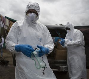 An ambulance team prepares to collect a body suspected of being infected with Ebola.