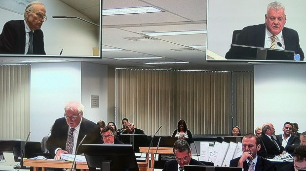 George Alex (lower far right) listens as Jim Byrnes (top right) gives evidence.