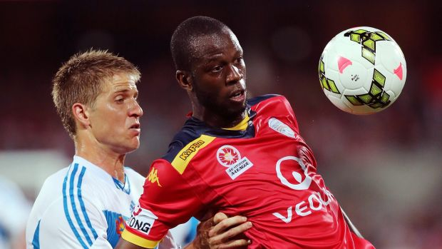 Watch it: Adrian Leijer and Bruce Djite battle it out.