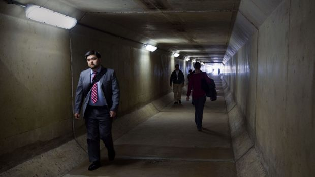 Alarm: Pentagon workers walk through a pedestrian tunnel in the South Parking lot area that crosses under Interstate 95 ...
