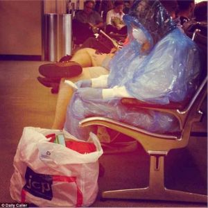 A woman wears a Hazmat suit at a US airport: it's unclear whether it was a stunt.