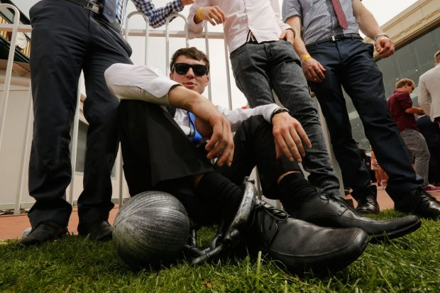 Cameron MacFarlane on his buck day enjoys the warm weather at the Caulfield Cup.
