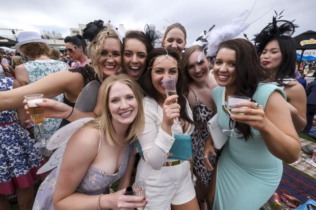 Fun in the sun, and clouds: racegoers at the Caulfield Cup.