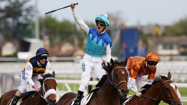 Zac Purton celebrates after taking out the Caulfield Cup aboard Admire Rakti.