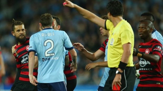 Marched: Vitor Saba (L) of the Wanderers scuffles with Sebastian Ryall after he was sent off.