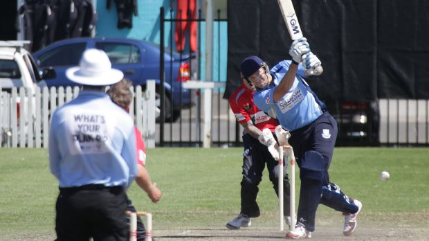 On the front foot: Shane Watson lashes out while playing for Sutherland against St George on the weekend.