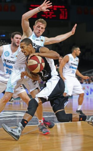 Melbourne United's Stephen Dennis is aggressive on the drive.