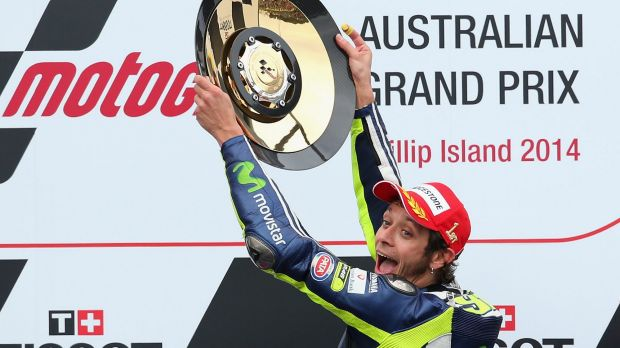 Valentino Rossi holds up his trophy.