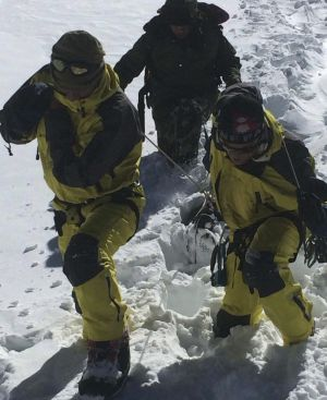 Nepalese army personnel drag the bodies of victims recovered after an avalanche at Thorang-La in Annapurna.