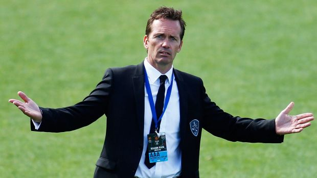 Brisbane Roar coach Mike Mulvey shows his frustration during the game against Perth Glory on Sunday.