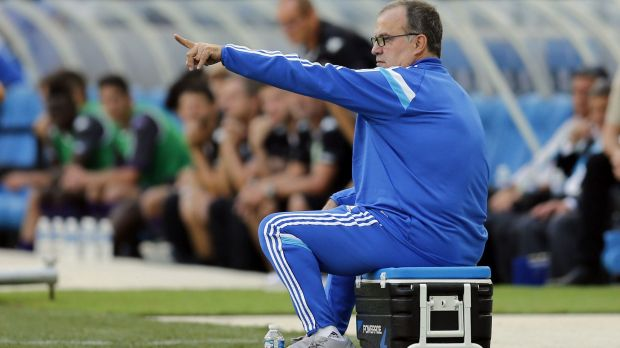 The only black mark on a fine afternoon for Marseille coach Bielsa came when he sat on his own cup of coffee in the ...
