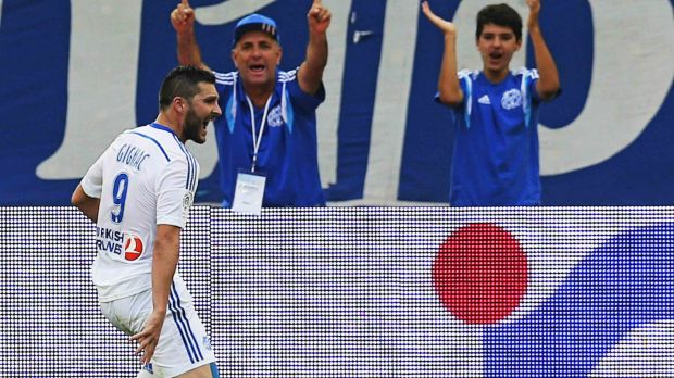 Andre-Pierre Gignac celebrates scoring against Toulouse.