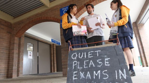 Doubts about science: Sitting the HSC biology exam on Monday were Gilroy Catholic College students (from left) Laura ...