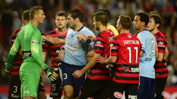 Sasa Ognenovski of Sydney FC scuffles with Wanderers players.