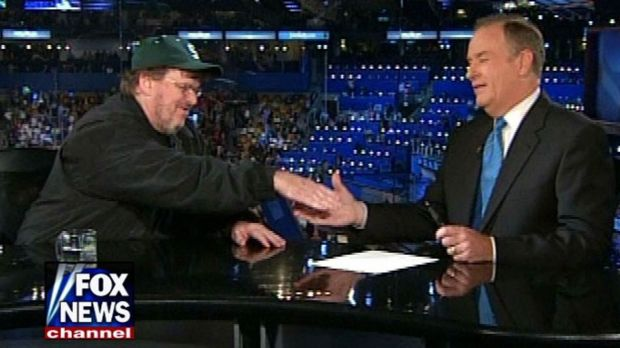 Left-wing filmaker Michael Moore shakes hands with right-wing commentator Bill O'Reilly on Fox News in the US.