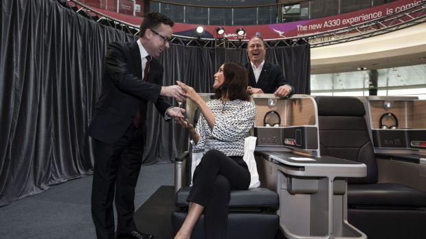 At leisure: Alan Joyce, chef Neil Perry and Qantas Friend Lindy Klim with a mock-up of the new business class configuration.
