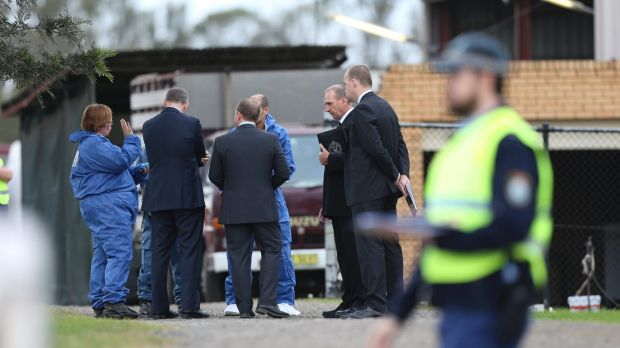 Police at Keith Cini's home in Badgerys Creek following his death in May: two men have been charged with murder.