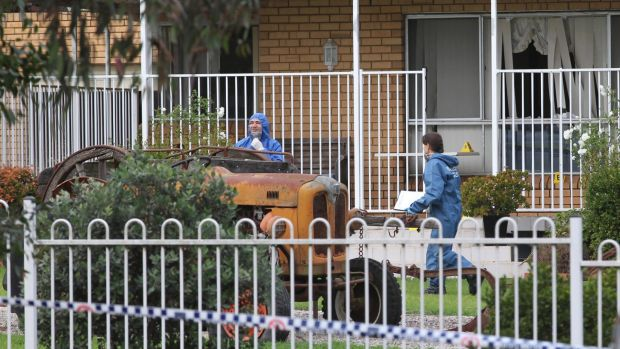Police at Mr Cini's home: his partner, Lucy, suffered head injuries.